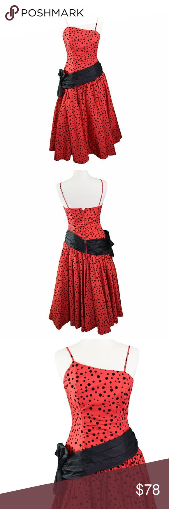 """Vintage 1980's Red and Black Formal Dress Perfect for V-Day! Vintage red dress w/ black applique polka dots. Asymmetrical neckline, structured bodice, drop waist, and side bow! Full skirt w/ a black petticoat. Small stain on the front below the bow. Two of the polka dots are missing on the bottom right of the skirt & there is some bleeding (see photo).The flaws are hardly noticeable b/c of how the skirt falls, unless inspected closely. Union-made. Size 8, Ankle length on me & I am 5'2"""", so…"""