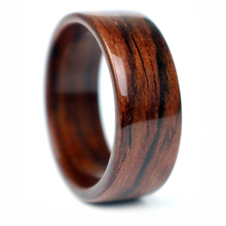 Rosewood Wooden Ring handmade in Chicago, IL. Each ring is unique and made from salvaged wood found in Chicago.