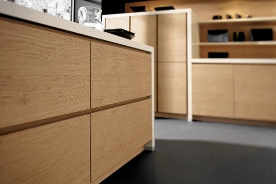 German outfit Alno produces contemporary kitchen systems that are Donald Judd-like in their simplicity and spareness, yet buffeted by sci-fi touches. Tempering the sleek lines are warm finish choices, including solid and veneered woods as well as woodlike laminates. Its Alnostarline Natureline—shown here in Wild Oak veneer—has quiet detailing: unframed door fronts with recessed pulls. The wood, though protected by lacquer, has a raw look. Costs vary widely because of customization options.