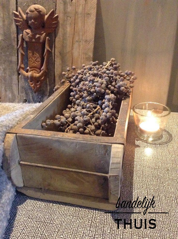 Oude, houten steenmal, mooi vergrijsd hout