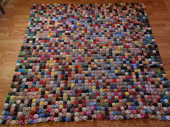 Gorgeous yoyo quilt for sale on Etsy- $555.00- similar to what I'm making right now. I will put a white backing on my version and I'm using a more limited color scheme- but THIS is amazing.