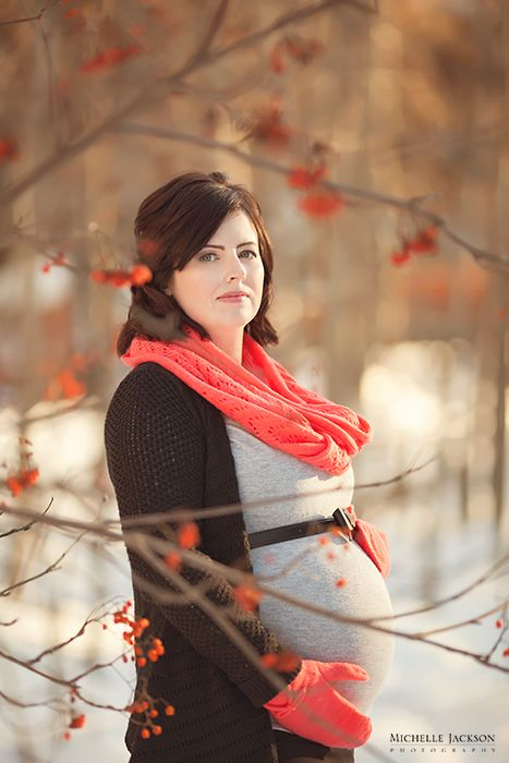 Maternity photo among red berries in the winter  January Snowy Sunset Maternity Session-Edmonton Maternity Photographer » Michelle Jackson Photography: Edmonton newborn photographer, Edmont...
