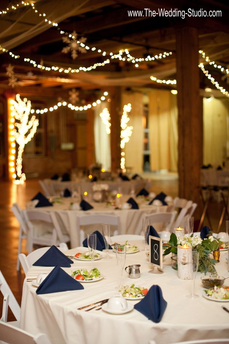 wedding reception venues woodstock ga%0A Twinkle lights strung from rustic wood beams above the wedding guest tables  at the Starline Factory