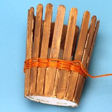 """Simple basket weaving kids craft with friendship thread - Monday """"Born to Save"""" for Moses basket. Could decorate with Southwest stickers and use as a pencil holder @ home."""
