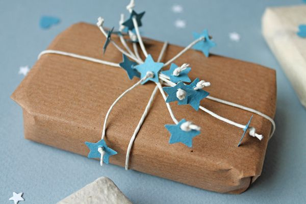 Tiny stars threaded into white elastic sparkles brown wrapping paper.