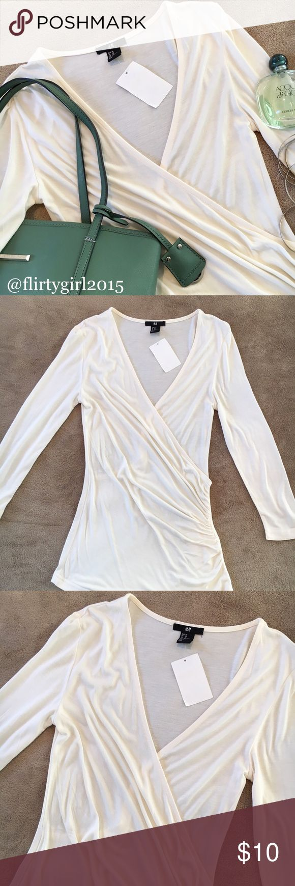 NWT H&M Top 💥NWT!! Surplice top with side ruching and long sleeves. From H&M. Size XS, true to size. Material is light and airy. Super soft. Makeup stain on the INSIDE of the shirt and is not noticeable at all, can upload picture if requested. Versatile white top. Dress it up, dress it down, throw it over a bikini and enjoy a bon fire after spending the day at the beach... endless possibilities. H&M Tops Tees - Long Sleeve
