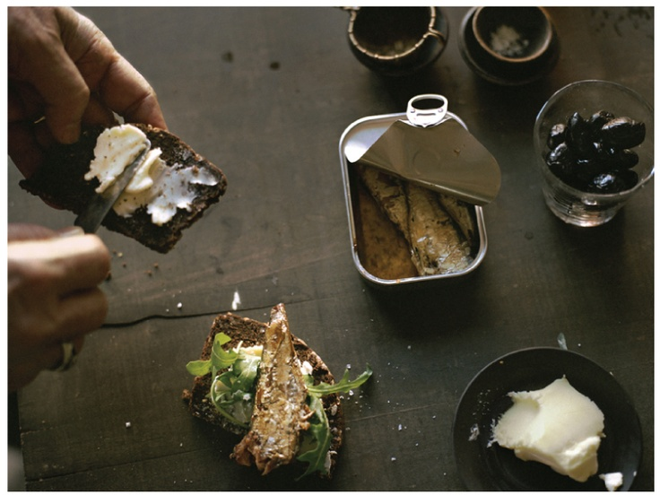 sardine & butter sandwich on brown bread with arugula and cracked pepper. photo by susanna howe.