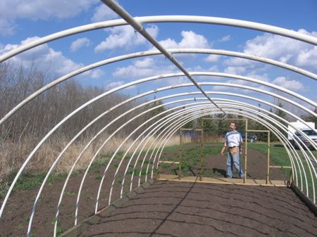 How to Build an Inexpensive Hoop-Style Greenhouse---lots of great pictures and clear instructions.