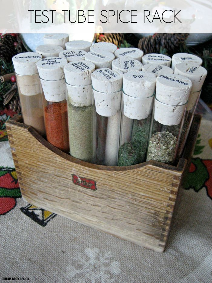 DIY test tube spice rack! A great and cheap alternative to your typical boring and messy spice cabinet. Costs under $20, compared to the $200 in stores, on dreambookdesign.com