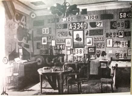 Manfred von Richthofen's trophy room during the First World War. There are several interesting things to note in the room, including the cut aircraft fabric across the walls, the rotary-engine lights, the propeller table legs, and the silver cups - under the portrait- made for his first 60 kills. Many of the trophies are believed to have been taken by the Soviets toward the end of WW2.