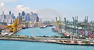 Landscape photograph of the Port of Singapore from Vivocity with a tram to…