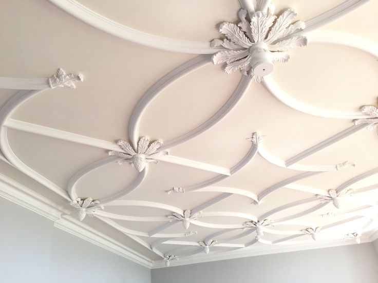 A bespoke ceiling design, by our craftsman. Includes strapwork and ceiling roses.