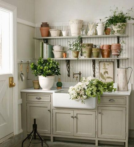 mudroom sinks - Mudroom with flower cutting sink in the corner of a garage - Country Living via Atticmag