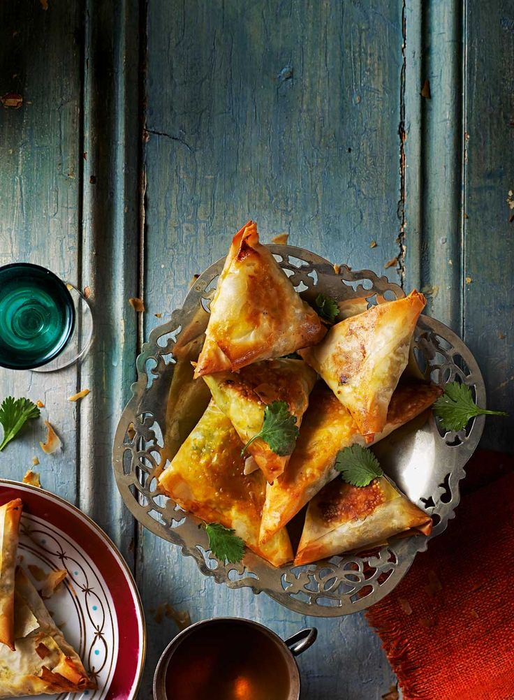 A spiced chicken filling with sweet apricots is encased in crisp filo pastry to make this Moroccan chicken recipe.