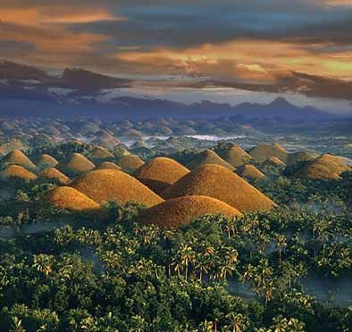 Chocolate Hills, Philippines  More than 1,770 perfectly cone-shaped hills can be found in the Central Visayas region of the Philippines, more exactly in Bohol. The hills look like a sea of chocolate kisses during the dry season. The unusual geological formation has baffled geologists for decades.