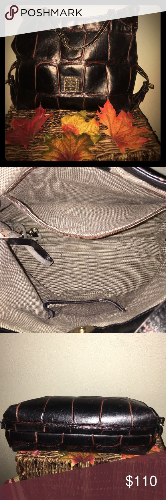🎁Dooney & Bourke cross body🎁 The richness of the wine 🍷 coloring in this clean, soft leather Dooney is stunning. Key lanyard and the standard phone 📱 pocket and zip 🤐 pocket inside. Light pink interior. This amazingly kept cross body or satchel is so worth the $$$ trust me. Comes with dust bag and extra strap for extension for the cross body. Dooney & Bourke Bags Satchels