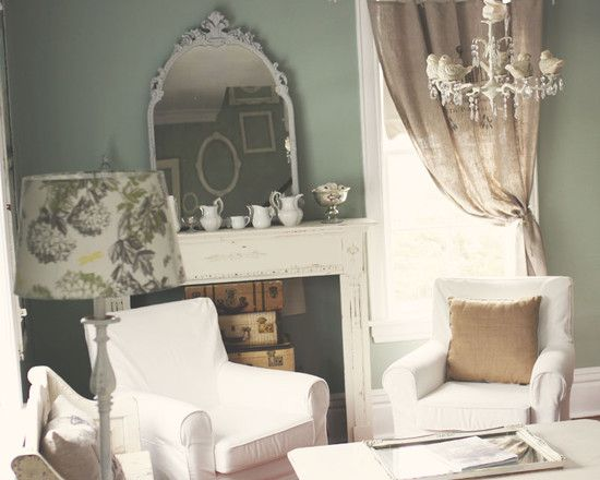 Chandelier <3 Fireplace <3 Suitcases in fireplace <3 <3 Curtain <3 Decor on mantle <3 <3 I love it all! :D