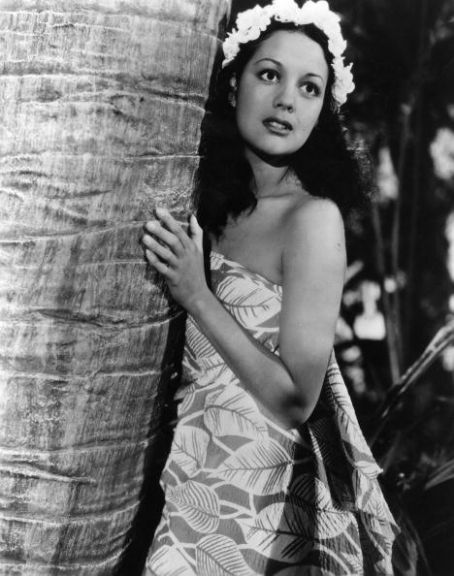 "Movita Castaneda--She played Franchot Tone's love interest in the 1935 version of ""Mutiny on the Bounty.""  Strangely enough, she was the second wife of Marlon Brando, who played Fletcher Christian in the 1962 remake.  They were divorced by that time.  At 96 (as of 3/14) she is the last surviving credited cast member of the 1935 film."