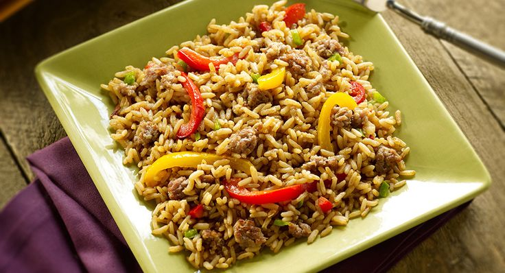 Create an authentic and flavorful Louisiana dish using Zatarain's Dirty Rice Mix, pork sausage, and red and yellow bell peppers.