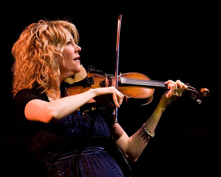 Natalie MacMaster, was born June 13, 1972 in the community of Troy in Inverness County, Nova Scotia, Canada and staying true to her roots, she plays Cape Breton fiddle music that's impossible not to fall in love with!