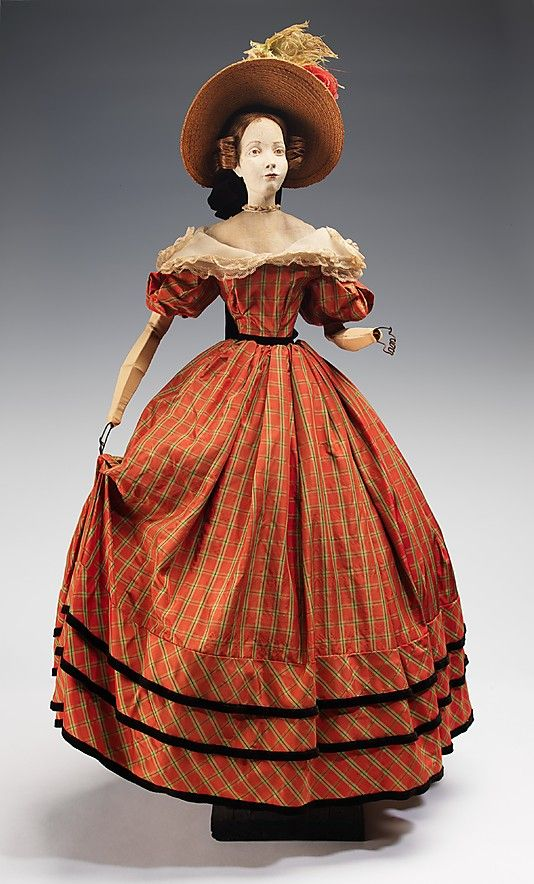 """1832 Doll"" Marcelle Dormoy (French) Designer: Rose Descat Designer: Antoine (French) Date: 1949 Culture: French Medium: metal, plaster, hair, silk, straw, cotton, feather, linen Dimensions: 32 1/2 x 17 in. (82.6 x 43.2 cm) Credit Line: Brooklyn Museum Costume Collection at The Metropolitan Museum of Art, Gift of the Brooklyn Museum, 2009; Gift of Syndicat de la Couture de Paris, 1949"