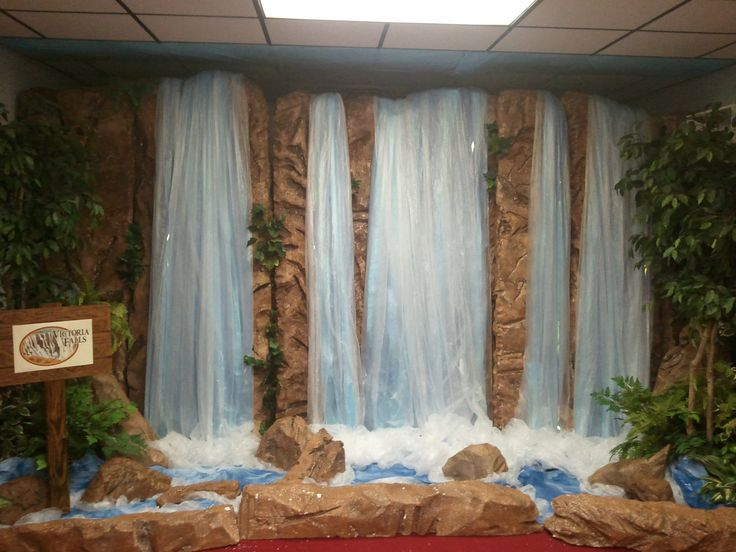 "Victoria Falls VBS prop made from 6"" thick styrofoam pieces, painter's drop cloth w/ lt. blue tablecloth & brown paper (painted blue) for the water. Begin by cutting grooves in the stryrofoam w/ knife, sawsall, rotozip, etc. Heat grooves with a heat gun to give it a more realistic look (wear a respirator as the fumes are toxic). Paint with a medium brown paint w/ mocha glazing mixed in. Add clear painter's plastic for water. Add greenery and watch your waterfall come to life before your eyes."
