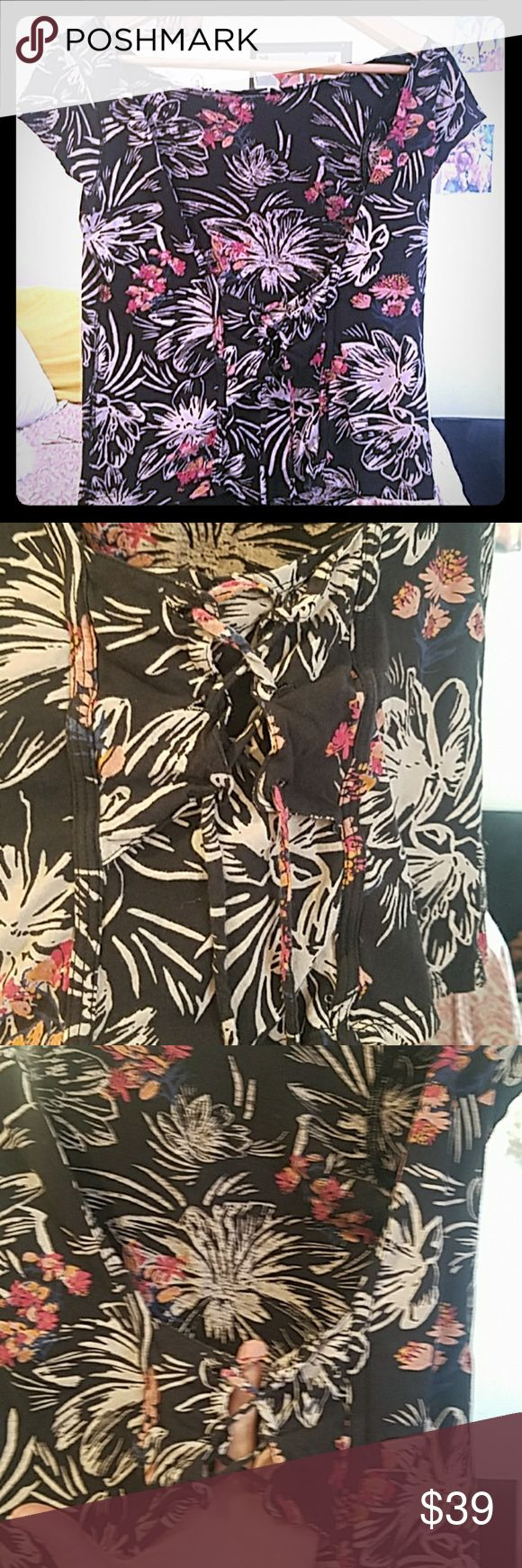 RARE Free People corset low back floral top Really cool shirt. Low scoop back, soft cotton, cap sleeves, corset detail with functional lacing at back. By we the free for free people. Size M, could fit sizes 2-8.  SELECT SIZE MEDIUM AT CHECKOUT ONLY ONE ITEM FOR SALE (M) Bundle 2 items and receive a big private discount... Free People Tops