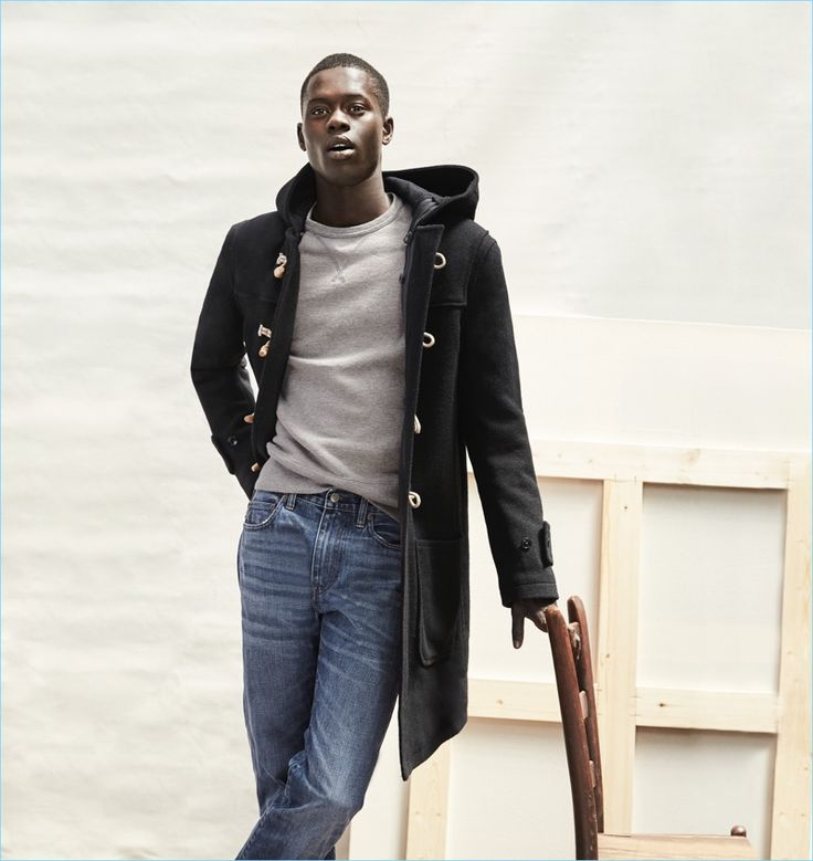 J.Crew makes a case for its classic dufflecoat. Here, model Alpha Dia wears it with the brand's 1040 athletic jeans.