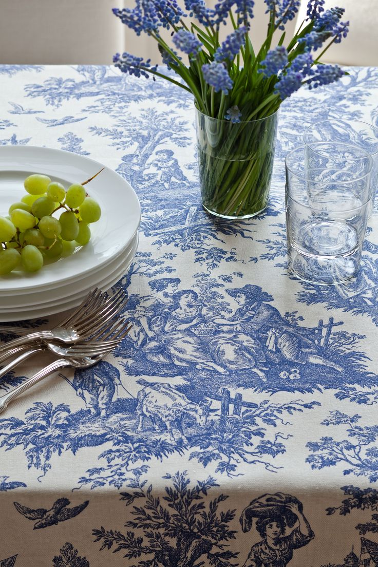 I like to use fabric, such as this blue toile, for tablecloths. I use iron-tape to make a hem- it couldn't be easier!
