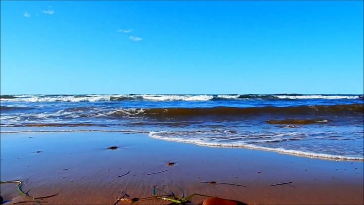 Cavendish Beach PEI - The Surf Rolls in , seen from down low