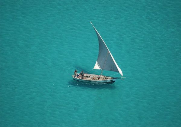 Local fishermen in their traditional Dhow boat.