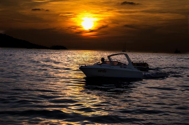 Crossing the ocean at sunset hour Thailand