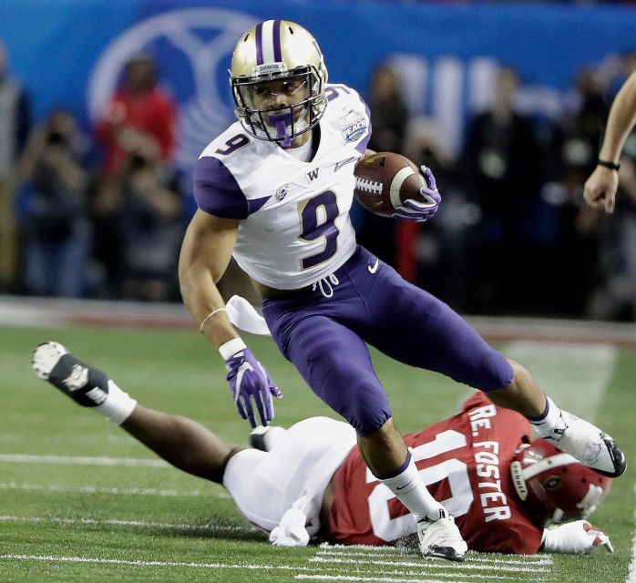 Washington running back Myles Gaskin (9) runs past Alabama linebacker Reuben Foster (10) during the first half of the Peach Bowl NCAA college football playoff game, Saturday, Dec. 31, 2016, in Atlanta.