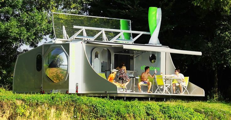 When traveling, the sCarabane is a boxy mobile garage, but once you're at camp, the trailer unfolds to reveal a spacious, 420-square-foot tiny house.
