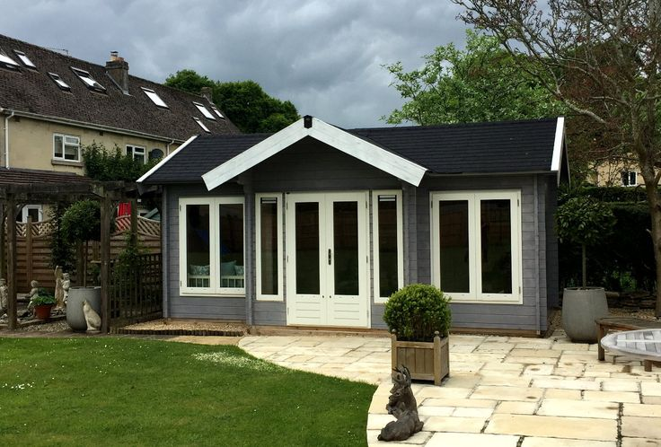 Large traditional summerhouse with canopy. Painted grey