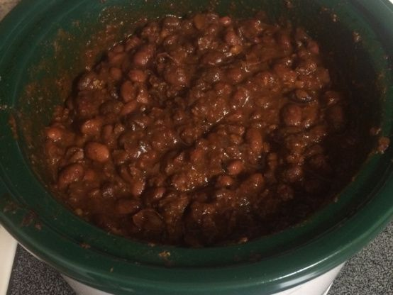 I dont remember how I came about this recipe, but it beat out my dads chili in our family chili cookoff! This is powerful chili, so tailor the spices to your liking. I like to serve my chili over corn bread or fritos, and top it with cheddar and onions.My mom in law serves it over rice.