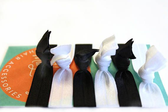 Black Tie Elastic Hair Tie Package  This package includes: ♥ three black hair ties ♥ three white hair ties  These gentle stretchy hair ties wont crease most hair and can also be worn as stylish bracelets. Perfect as a thank you gift, stocking stuffer, bridesmaid gift or a card stuffer!