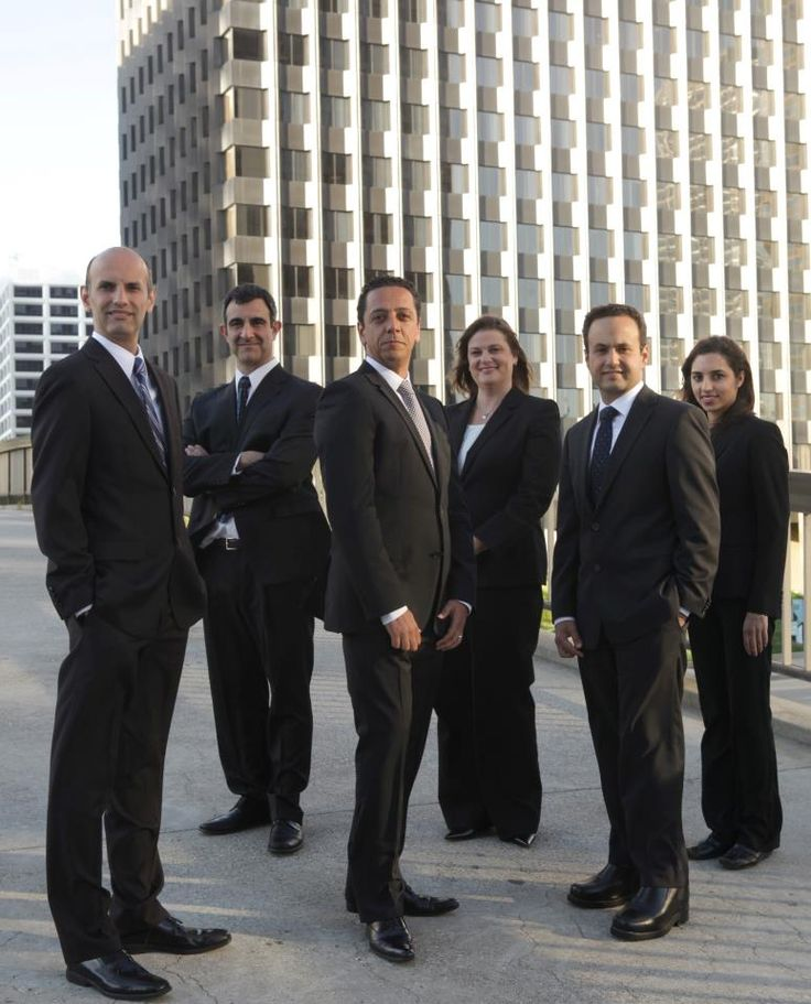 Our team of attorneys — with Pedram Minoofar, Bahram Niknia, Navid Yadegar, Marcia Sharp, Navid Soleymani and Kavita Tekchandani at Yadegar, Minoofar & Soleymani LLP.