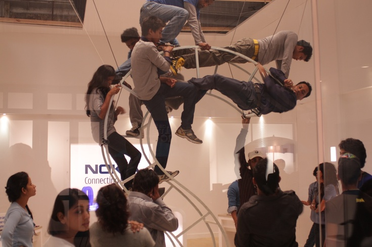 Our trained acrobats climb on the top of '?'. Trick is to cover the metal '?' so it looks like a human question mark.