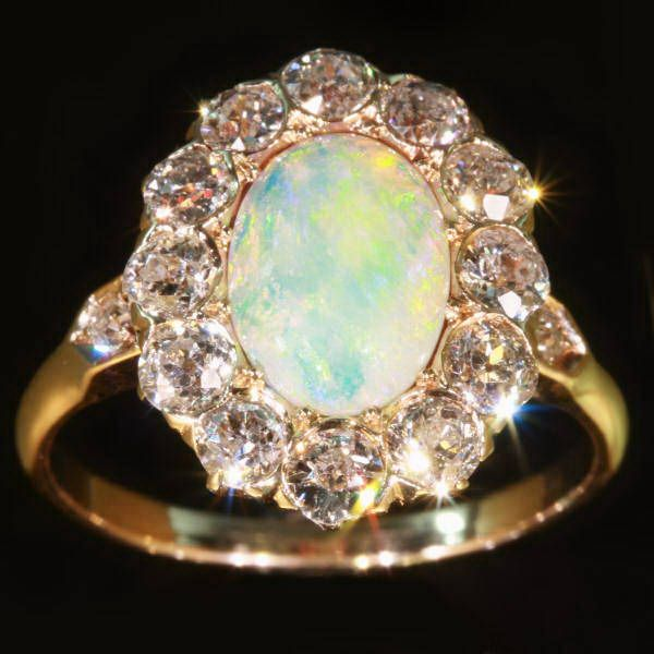 vintage opal and diamond engagement ring. those are some big rocks around the outside though!