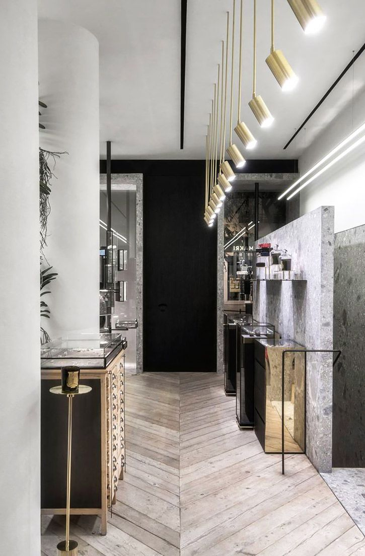 Modern and industrial interior with marble slab wall, hardwood floors, and mirrored accents.