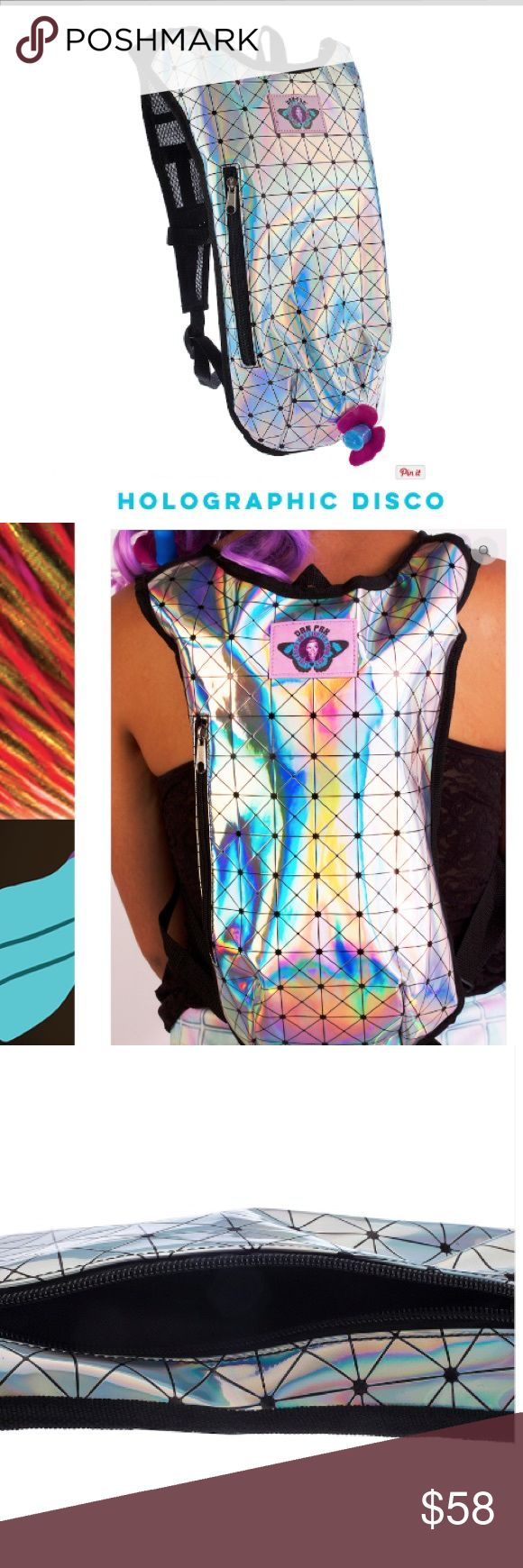 """Camelback hologram holographic silver Dan Pak Dan-Pak unique """"disco"""" camelbak in holographic silver. Used only once, great condition, comes with bladder inside. Cute unique water pack ! Has a zipper pocket on the front side and also on the back. Great for festivals , events , raves, Coachella etc. tags: unif dollskill iheartraves black milk lip service nasty gal mi gente little black diamond we'll rave wonderland j valentine hot topic vibedration spray ground Bags Backpacks"""