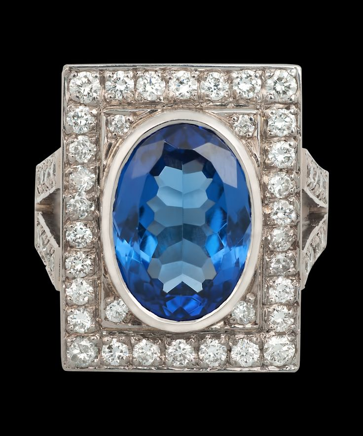 A vintage tanzanite and diamond plaque ring. From the Kojis Ring Collection.