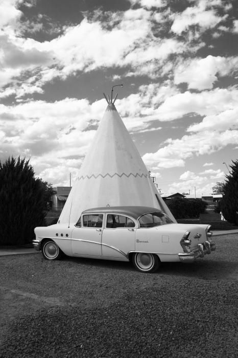 Route 66. One of two remaining wigwam motels on old Rt. 66, this one located in Holbrook, Arizona. Each concrete teepee featured its own classic car nearby. I wasn't sure that this really was a functioning motel until I saw a maid's cart parked outside one of the wigwams. The nice lady let me peek inside, revealing a round but ordinary hotel room. Black and white.