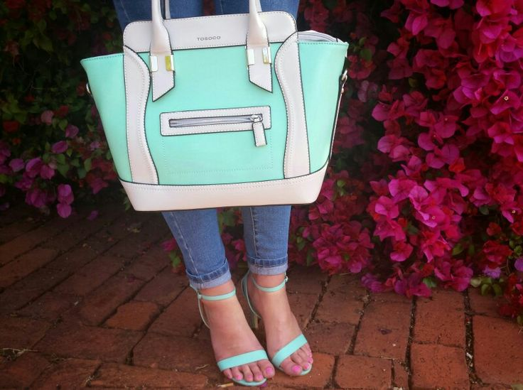 Mint / turquoise handbag and high heels. Spring accessories