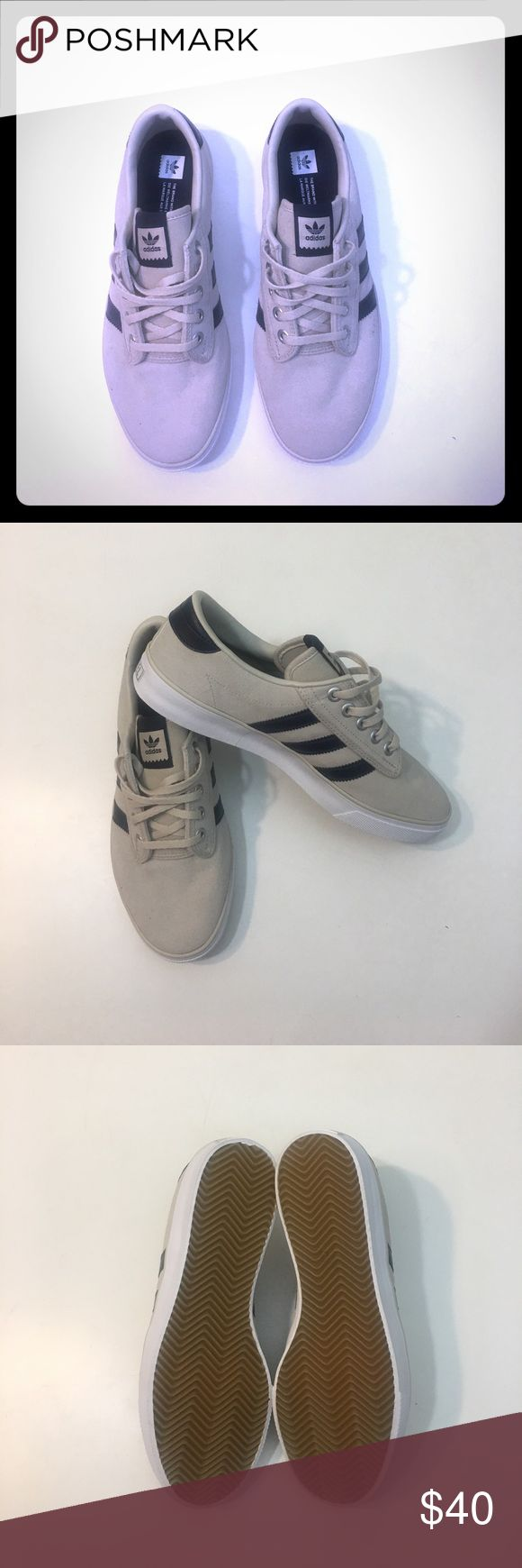 Sz 10-10.5 42 BNWOB ADIDAS ORIGINALS DECK SHOES Super cool Adidas Originals Kiel deck shoes. Reproduction of shoes made for the 1972 Kiel Olympics (German Sailing Team). Cool off-white suede upper with navy leather details. Unworn and pristine. I have like 10 pairs of these, and they look great with everything. Sadly these are too small. My loss, your gain. Sigh. Adidas Shoes Sneakers