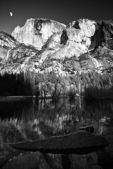 Ansel Adams, reflection spread throughtout the entire lower half of the photo, fantastic composition and high contrast, i especially like this piece because of the way the nature looks so peaceful, untouched.