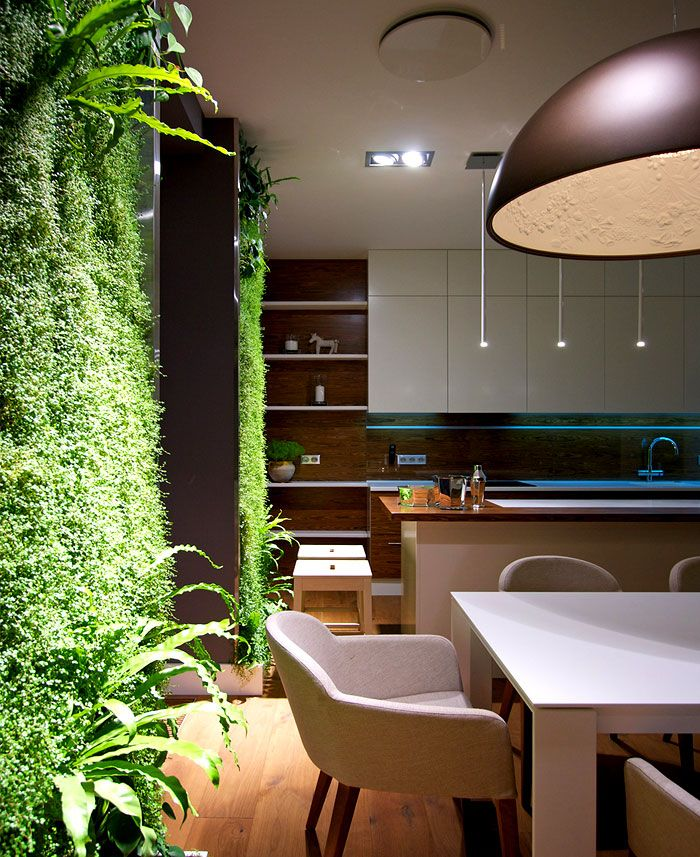 Sophisticated Studio Apartment by SVOYA Studio  luxuriant green walls