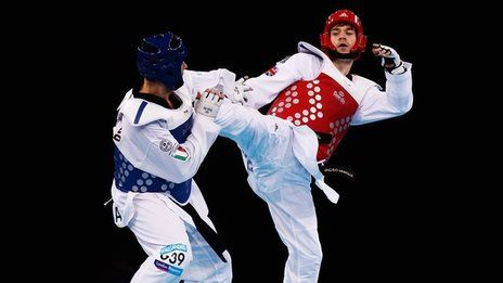 Aaron Cook has vowed to continue fighting for the Isle of Man and not the GB Taekwondo programme after reclaiming world number one status.