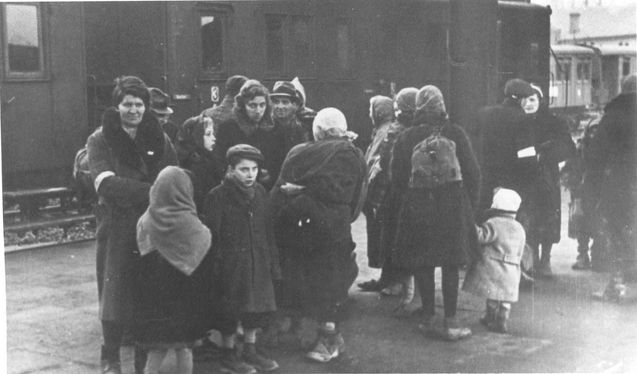 Krakow, Poland, Families at the train station during deportation. So sad to see these wonderful people being shipped to their untimely deaths